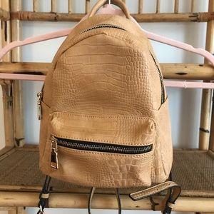 Louenhide tan vegan mini backpack